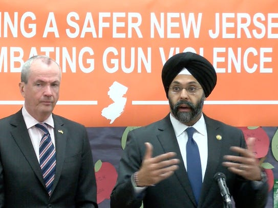 Gov. Phil Murphy (left) was joined by Attorney General Gurbir Grewal at the Dr. Martin Luther King Middle School in Asbury Park on April 6, 2018 to sign an executive order on gun safety.