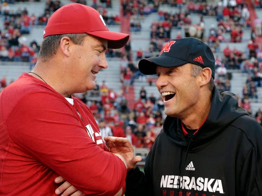 Nebraska head coach Mike Riley, right, chats with Wisconsin head coach Paul Chryst before an NCAA college football game in Lincoln, Neb., Saturday, Oct. 7, 2017. (AP Photo/Nati Harnik)