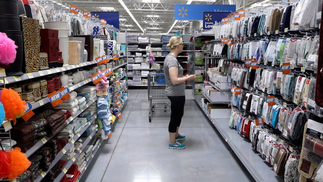 A customer shops for home accessories at a Wal-Mart Supercenter store in Springdale, Ark., on  June 4, 2015.