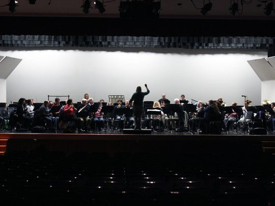 """Members of the Raritan Valley Symphonic Band rehearse at Bridgewater-Raritan High school for their upcoming family concert called """"Movie Magic"""" which will highlight music from movies. The concert will take place at Bridgewater-Raritan High School on Feb. 1 and is free to attend. Here conductor Meredith S. Boyan takes the band though one of the many songs that will be played at the concert."""