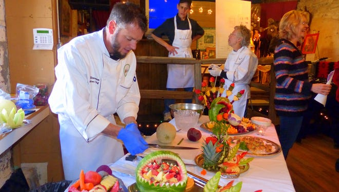 A table loaded with colorful fruit treats greeted visitors to the White Apron Society benefit for the Old Mill benefit, where artwork and jewelry were sold, and a silent auction for pottery pieces by local artists was conducted.