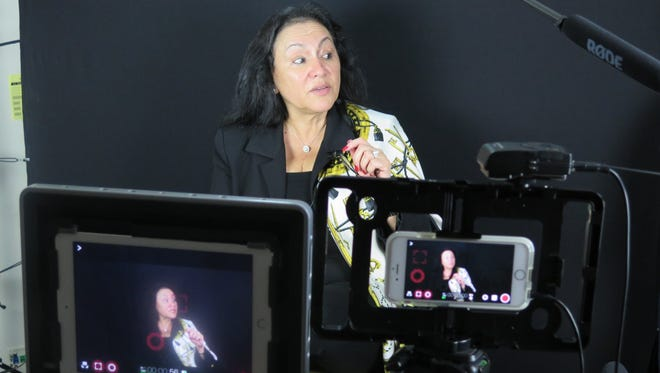 Regents Chancellor Betty Rosa being filmed and interviewed by students at New Rochelle High School.