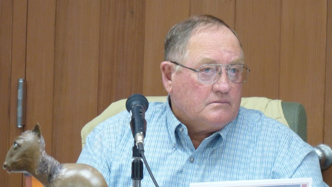 Preston Stone, chairman of the Lincoln County Commission, will sign future liens, but reluctantly.