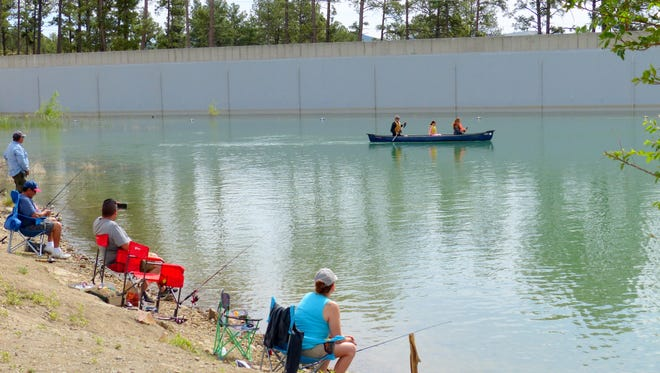 Small boats with electric motors will be allowed this summer at Grindstone Lake. Canoes and kayaks already are paddled around the fishing reservoir.