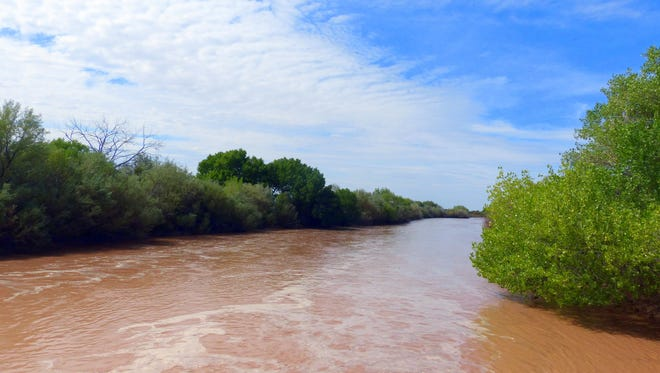 The Rio Grande was flowing heavily Friday after two substantial thunderstorms in the last few days.