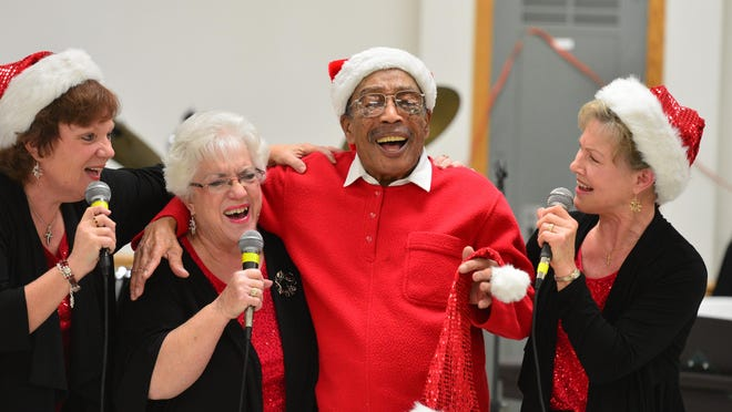"In 2012, Jimmy Binkley joins the party as ""9 to Five"" singers Donna Bordner, left, Gladys Ivey, center left, and Phyllis Draper, right, sing during the annual Jimmy Binkley  Christmas Party for Seniors in Bartonville."