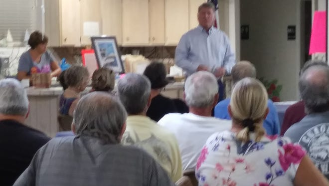 Noel Andress, a member of a committee studying incorporation of Pine Island and Matlacha, speaks to a crowded meeting of the Matlacha Civic Association