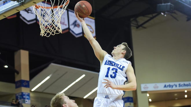 UNC Asheville guard David Robertson (13) struggled early in the season but is averaging 17 points in the Bulldogs' five Big South games.