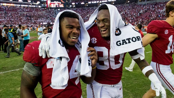 Alabama running back Damien Harris (34) and linebacker Mack Wilson (30) walk off the field after defeating Tennessee at Bryant-Denny Stadium in Tuscaloosa, Ala. on Saturday October 21, 2017.