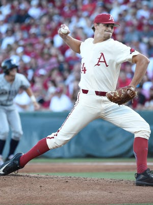 Arkansas reliever Jake Reindl delivers a pitch against Dallas Baptist on Sunday in the championship game of the Fayetteville Regional at Baum Stadium.