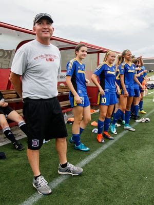 Catholic Memorial head coach John Burke watches the final seconds count down as his team wins a sixth consecutive WIAA Division 3 state soccer championship at Uihlein Soccer Park in Milwaukee on Saturday, June 17, 2017. The Crusaders secured the title in dominant fashion with a 4-0 victory over Winneconne.