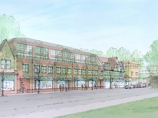 A rendering of a proposed four-story apartment building