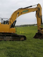 An excavator is parked Monday, May 4, 2015, at the exit from Interstate 65 to Indiana 25. Construction is slated to begin at the end of May to widen I-65 from the current four lanes to six. Work will begin first on the stretch of I-65 between Indiana 25 and Indiana 26.