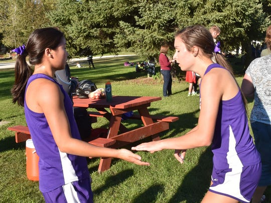 Kewaunee's Brianne Barta, left, and Amanda Vandenplas finish third and fourth respectively in the Kewaunee Cross Country Invitational at Bruemmer Park on Sept. 21.