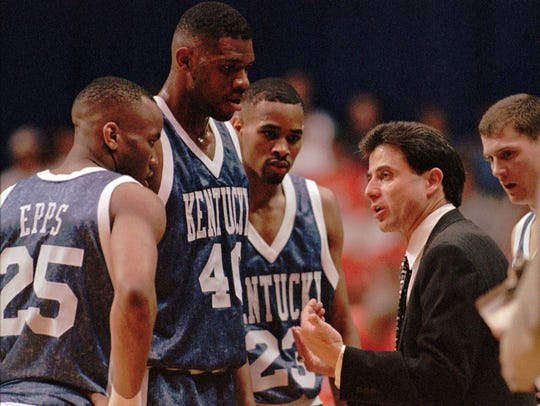 Derek Anderson (23) stands alongside teammates Walter McCarthy (40) and Anthony Epps (25) as then-coach Rick Pitino speaks during a game vs. Auburn. Feb. 27, 1996