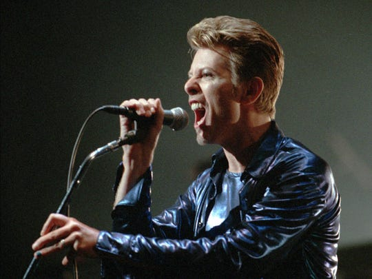 David Bowie sings during his 1995 U.S. tour kick-off in Connecticut.