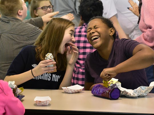Chloe Singleton, left, and Ashira Branche, both 13-years-old, enjoy converstaiton during a lunch period at Chambesburg Area Middle School North Monday, February 1, 2016. Plans are in the works to expand the cafeteria at CAMS North.