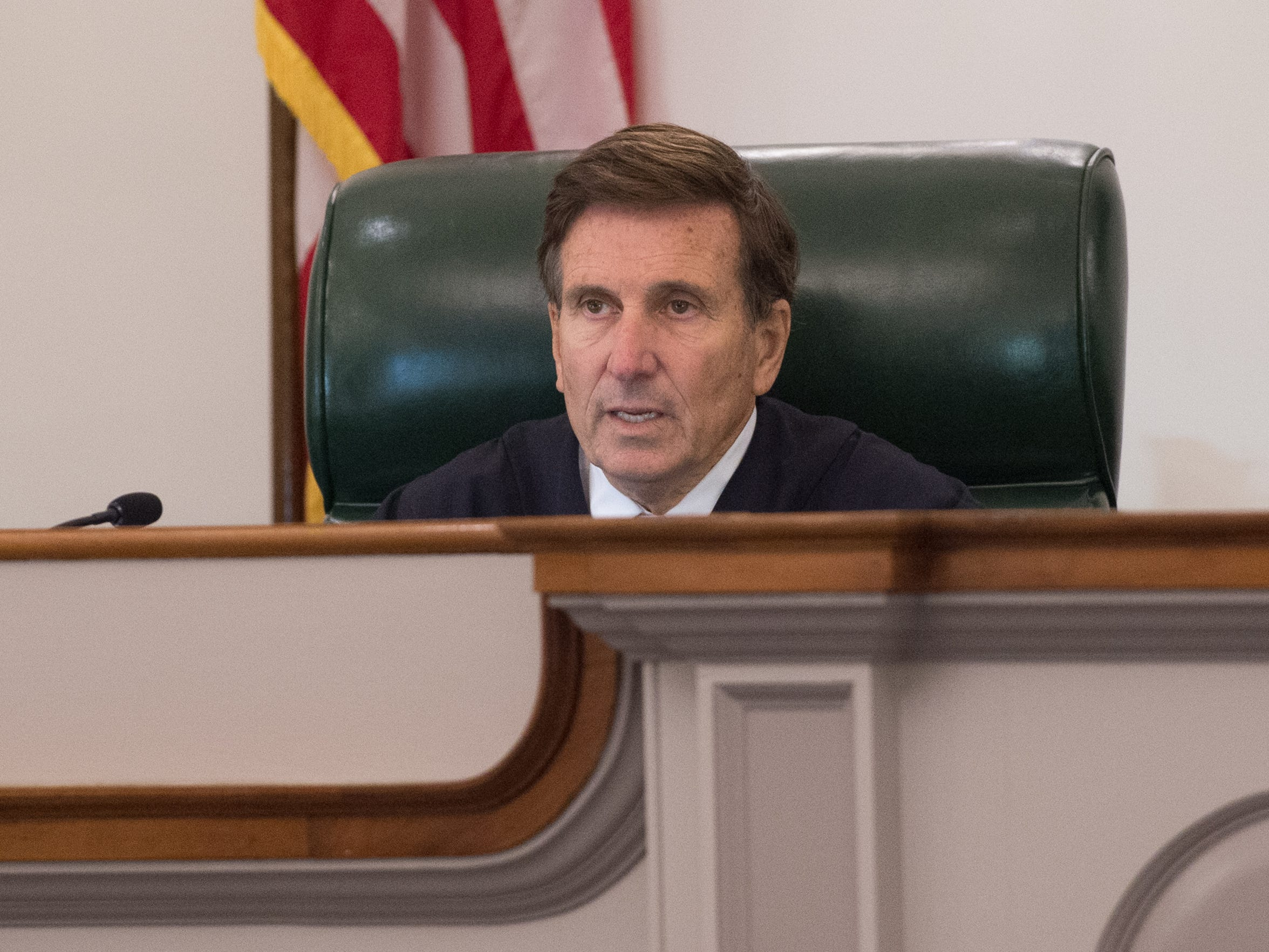 Delaware Supreme Court Justice Randy J. Holland asks a question during arguments over whether a lower court judge erred by ordering the Department of Correction to move defendant Isaiah McCoy out of solitary confinement. McCoy was convicted of first-degree murder and sentenced to death, before the Supreme Court overturned his conviction and ordered a retrial last year.