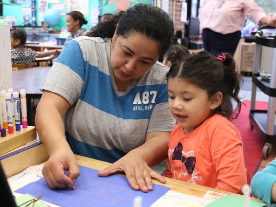 """The Middlesex County College Child Care Center in Edison celebrated an early Mother's Day with """"Muffins with Mom"""" on May 6. Moms were invited to enjoy breakfast with their children and have some fun. Here Ana Aguiar of North Brunswick helps her daughter Samantha Aguiar with some coloring."""