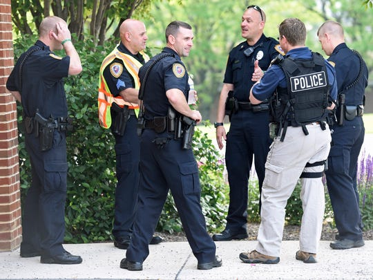 Chambersburg Police meet outside before conducting an active shooter drill Thursday morning, May 26, 2016 at Chambersburg Hospital.