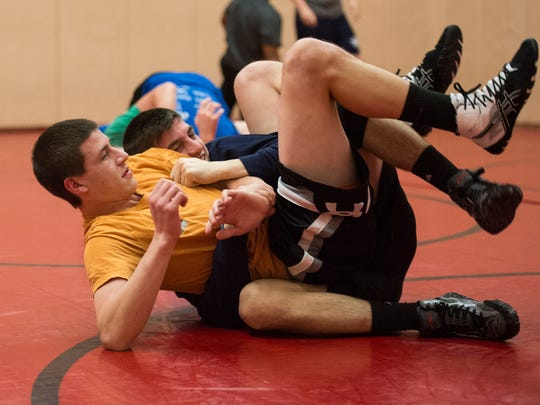 Annville-Cleona'a John Allen (foreground) tries to escape from Zach Renninger  during a recent practice.
