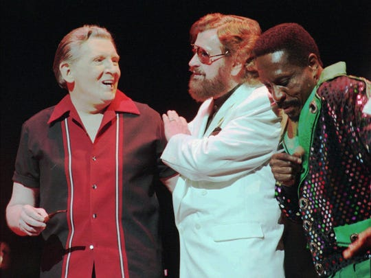 Rock 'n' roll recording pioneer Sam Phillips, center, chats with Jerry Lee Lewis, left, and Ike Turner at a Thursday, June 8, 2000, party honoring Phillips in Memphis, Tenn. The party featured the Memphis debut of an A&E biography of Phillips.