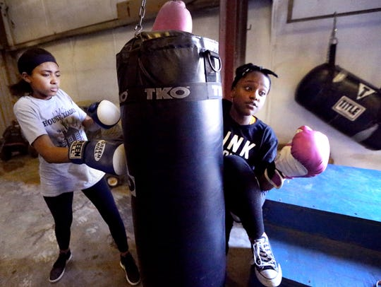 Teriana Manning, 13 left hits a heavy bag as Ayannah