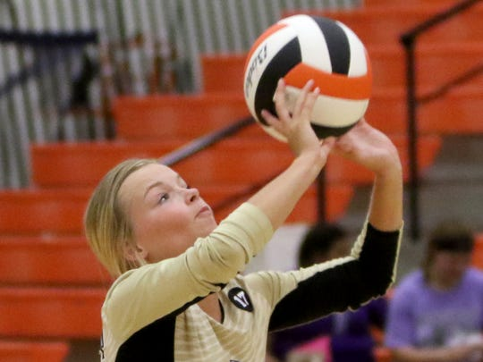 Henrietta's Chelsea Burns sends the ball back over to Boyd Saturday, Aug. 12, 2017, at the Cool in Boomtown tounament in Burkburnett.