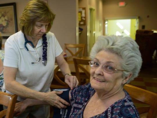 Community nurse Dee Parson, left,  takes Joan Noack's blood pressure at Episcopal Square on Thursday morning, August 17, 2017 in Shippensburg.