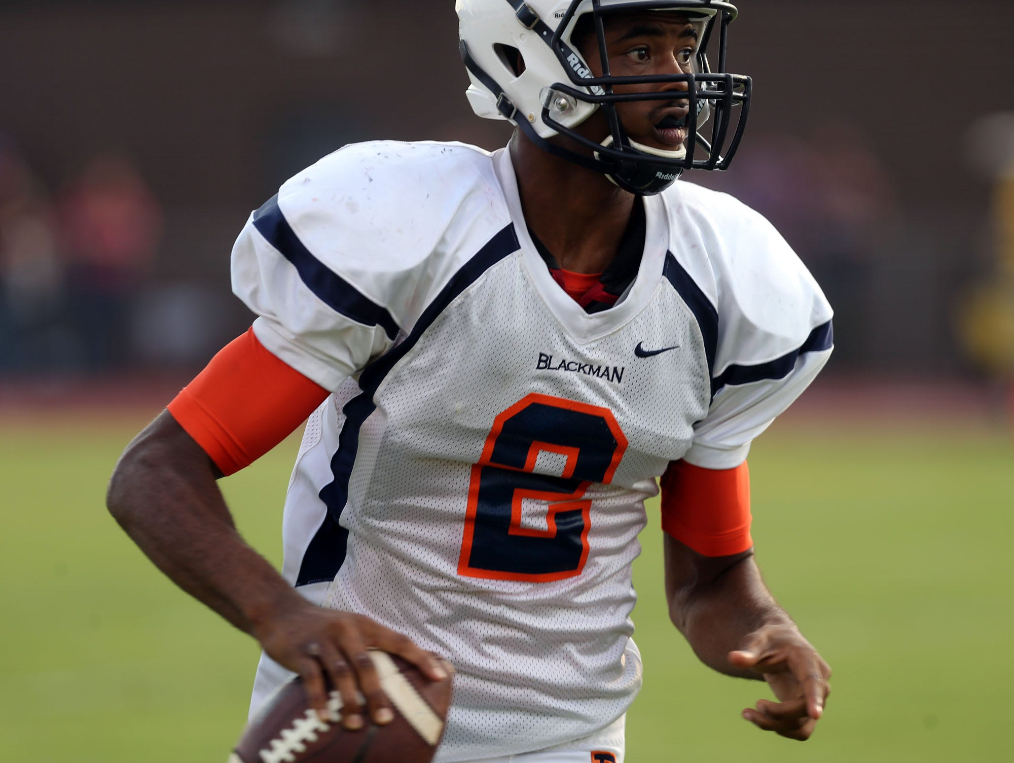Blackman quarterback Jauan Jennings looks for a receiver during the football jamboree Friday, August 15, 2014 at Smyrna High School.