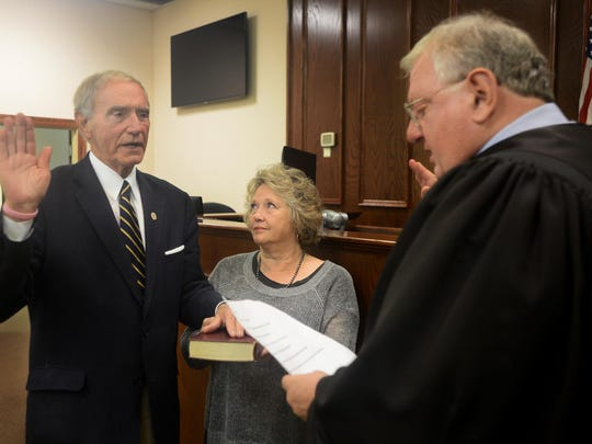 Jackson City Court Judge Blake Anderson performs the swearing-in ceremony for Jackson City Mayor Jerry Gist.