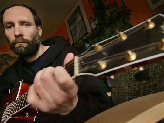 Doug Martsch, of the band Built to Spill, plays his guitar in the front of his home in Boise, Idaho, 2006.