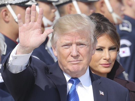 President Donald Trump and first lady Melania Trump arrive at Osan Air Base in Pyeongtaek, South Korea, on Tuesday. Lee Jin-man/AP U.S. President Donald Trump waves as first lady Melania Trump, center right, stands upon their arrival at Osan Air Base in Pyeongtaek, South Korea, Tuesday, Nov. 7, 2017. Trump arrived here on the second leg of his five-nation Asian tour and will hold a summit with South Korean President Moon Jae-in. (AP Photo/Lee Jin-man)