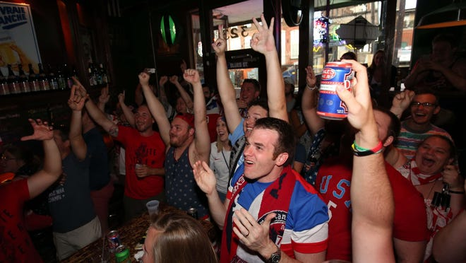 Fans of the US Women's World Cup team celebrate the team's fourth goal during a watch party at Skinny Slim's in downtown Springfield on Sunday.