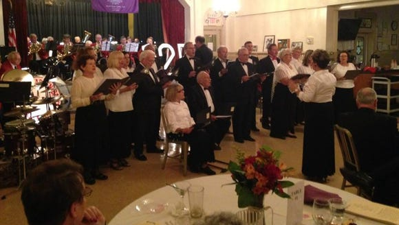 """York Elks Lodge's chorus sings """"We're from York,"""" accompanied"""