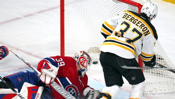 Boston Bruins center Patrice Bergeron scores a goal