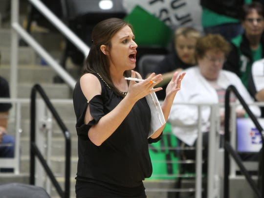 Tiago Head Volleyball Coach Mindy Patton, Windthorst and Midwestern State graduate, talks her players from the sideline in the 1A State Volleyball Championship final Thursday, Nov. 17, 2016, at the Curtis Culwell Center in Garland. The Lady Bulldogs won in five sets against Bronte to become the 1A State Volleyball Champions.