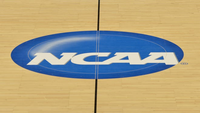 The NCAA logo at midcourt prior to the second round of the 2015 NCAA Basketball Championship a the Moda Center.