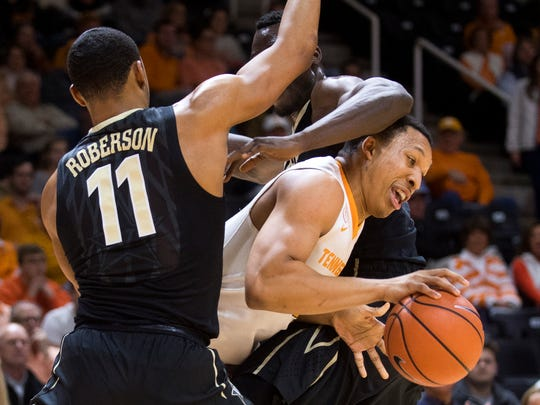 Tennessee forward Grant Williams (2) moves between Vanderbilt forward Jeff Roberson (11) and Vanderbilt center Djery Baptiste (12) during Tennessee's home basketball game against Vanderbilt at Thompson-Boling Arena on Tuesday, January 23, 2018.