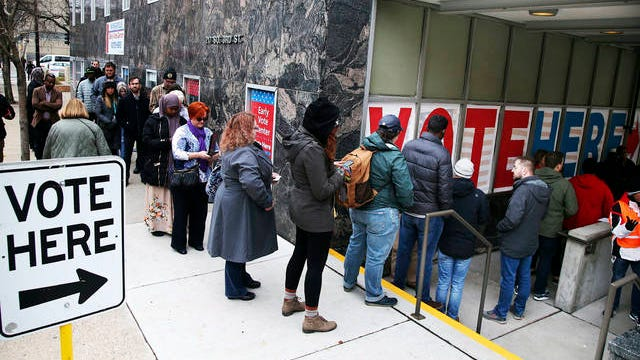 In this Nov. 5, 2018 file photo, people line up to vote on the last day of early voting at the Minneapolis Early Vote Center in Minneapolis. The Super Tuesday presidential primary is March 3.