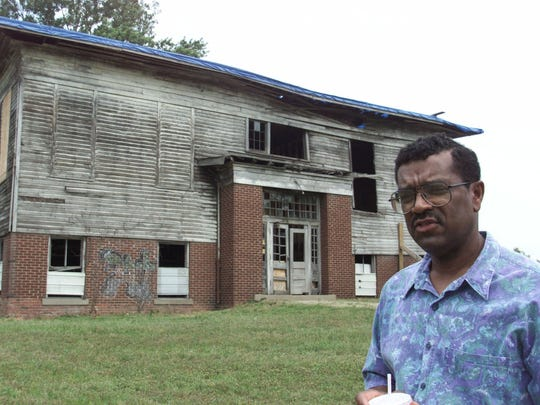 Stanley Madison, whose ancestors helped found Lyles Station, Ind., poses outside the old Lyles Consolidated School where the federal government is expected to pay $1.25 million to convert the building into a place where today's students can learn about the area's history. The Gibson County town in the southwestern courner of Indiana was founded by freed slaves more than 150 years ago. (AP Photo/Michael Conroy)