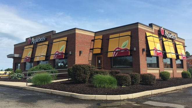 New over-sized, bright yellow and red contemporary awnings have brightened façade at Applebee's, which remodeled for the first time since opening in 1995.