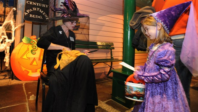 A princess trick-or-treats at the Detroit Historical Museum.