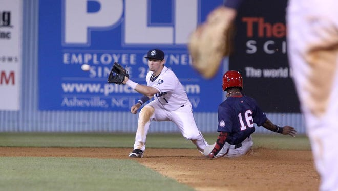 Asheville Tourists shortstop Brendan Rodgers tries to get a runner out at second during Tuesday's game against the Hagerstown Suns.  The Suns took the win with a final score of 8-7.-Colby Rabon (colbyrabon@gmail.com) April 26, 2016