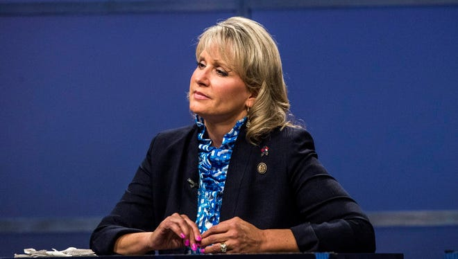 In this May 19, 2016, file photo, Rep. Renee Ellmers listens while facing off with Greg Brannon and Rep. George Holding during the 2nd District Republican primary debate at WRAL studio in Raleigh, N.C.