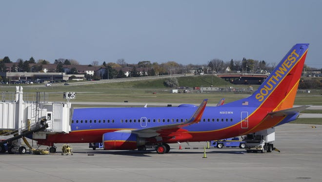 A Southwest Airlines jet is parked at a gate at Milwaukee's Mitchell International Airport.