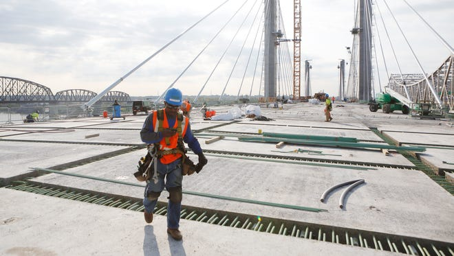 Construction worker Kyron Anderson walked across the new downtown bridge.  The new structure is expected to open a month earlier than was thought. Oct. 12, 2015.