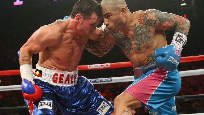 Miguel Cotto, right, and Daniel Geale exchange punches during their WBC middleweight title fight . (Photo Ed Mulholland/Getty Images)