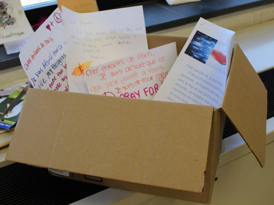 "Warren Middle School students will send approximately 50 letters and 1,000 ""peace cranes"" to Paris."