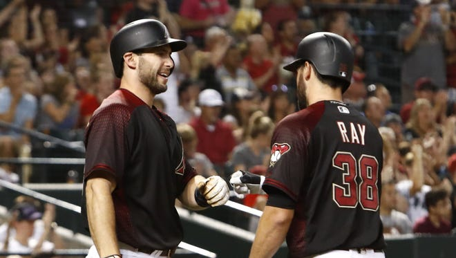 Arizona Diamondbacks Robbie Ray (38) celebrates after he scored a run with Paul Goldschmidt (44) during the 5th inning against the Philadelphia Phillies on Saturday, June 24, 2017 at Chase Field in Phoenix, Ariz.